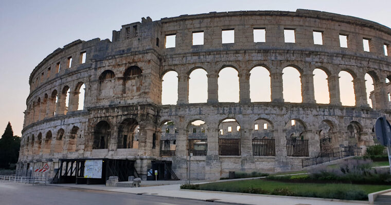 The Pula Ampitheatre at dawn, the gentle light makes the golden stone building glow