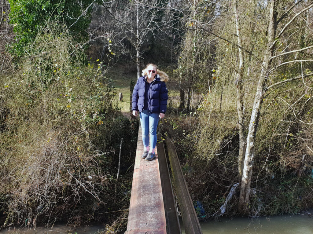 Zoe stood on a 30-centimetre wide metal plank that is acting as a bridge over a stream! Whilst she is smiling for the camera, she is totally scared of falling in. To make things worse, the plank is on an angle!