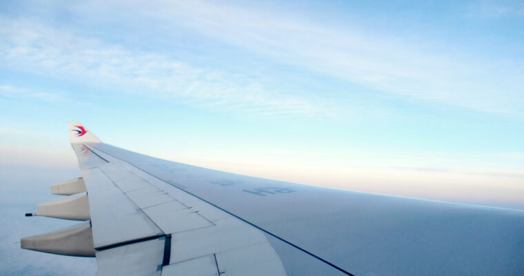 China Eastern plane wing in the sky at dawn.
