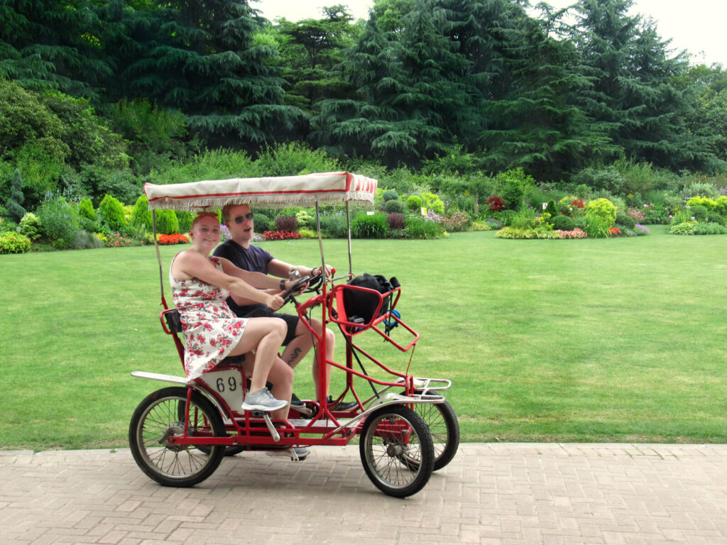 Zoe and boy Zoe enjoying a quadricycle in Shanghai's Century Park - a totally cool and efficient way to explore this huge park. Make sure this is part of your Shanghai 5-day itinerary!