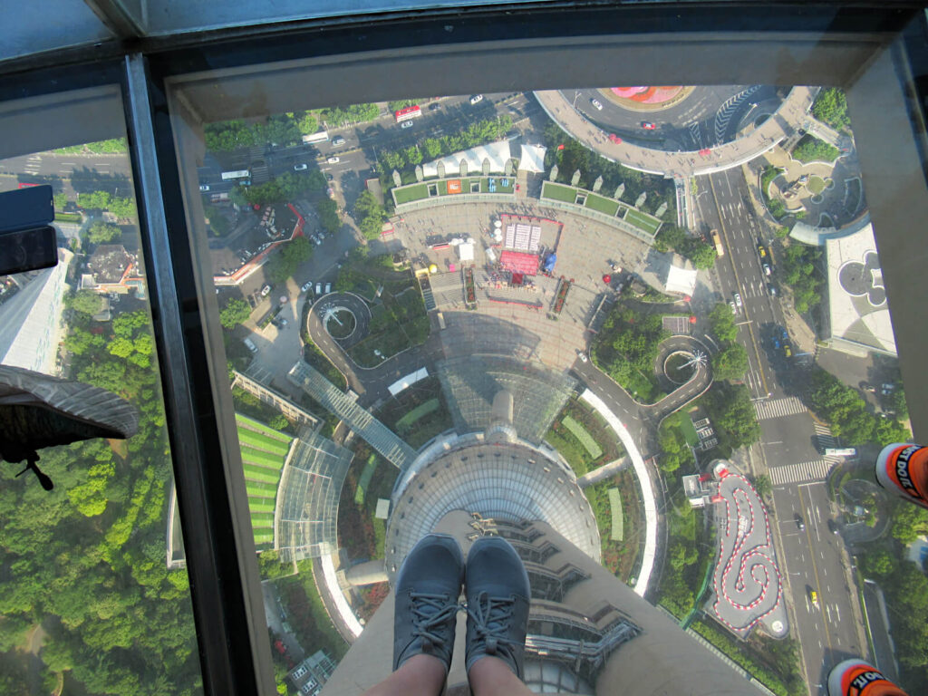 Looking down from the skydeck in the Shanghai TV Tower - 259 metres above the ground, and only glass stopping me from plummeting to my death! This alone is worth the entry fee to the TV tower!