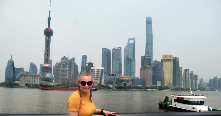 Zoe stood on the Bund with the famous Shanghai skyline behind.