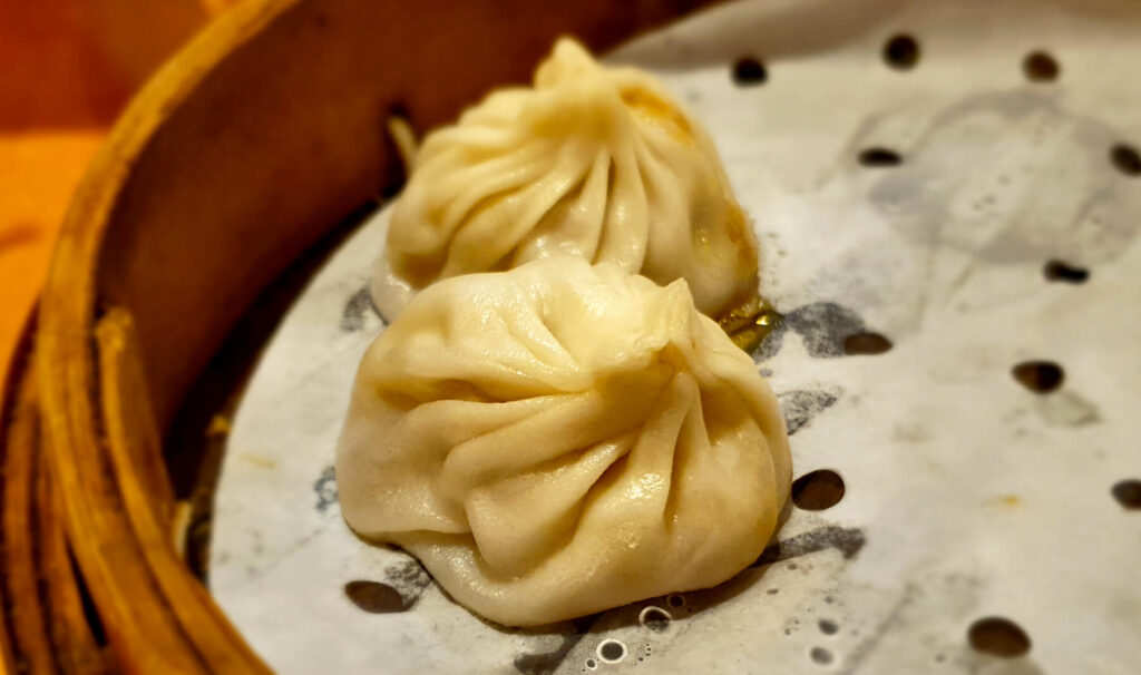 Shanghai speciality of xiaolongbao - meat soup dumplings. These are so amazing I would recommend putting a xiaolongbao restaurant on Shanghai 5-day itinerary!