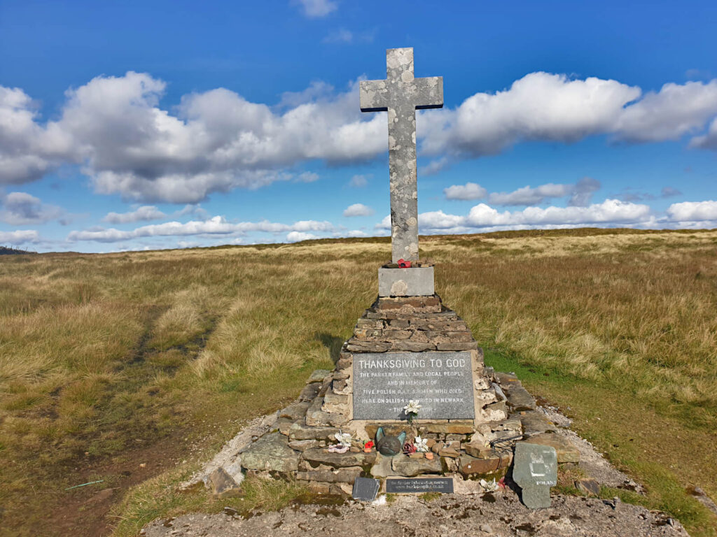 Stone cross on a loose brick memorial to the 5 Polish soldiers who died in a plane crash here in 1942. A poignant moment on this Buckden Pike Walk