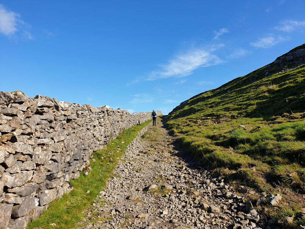 This Buckden Pike Walk starts steeply and carries on like this for quite a while! Picture shows a gravel like path climbing steeply toward the sky
