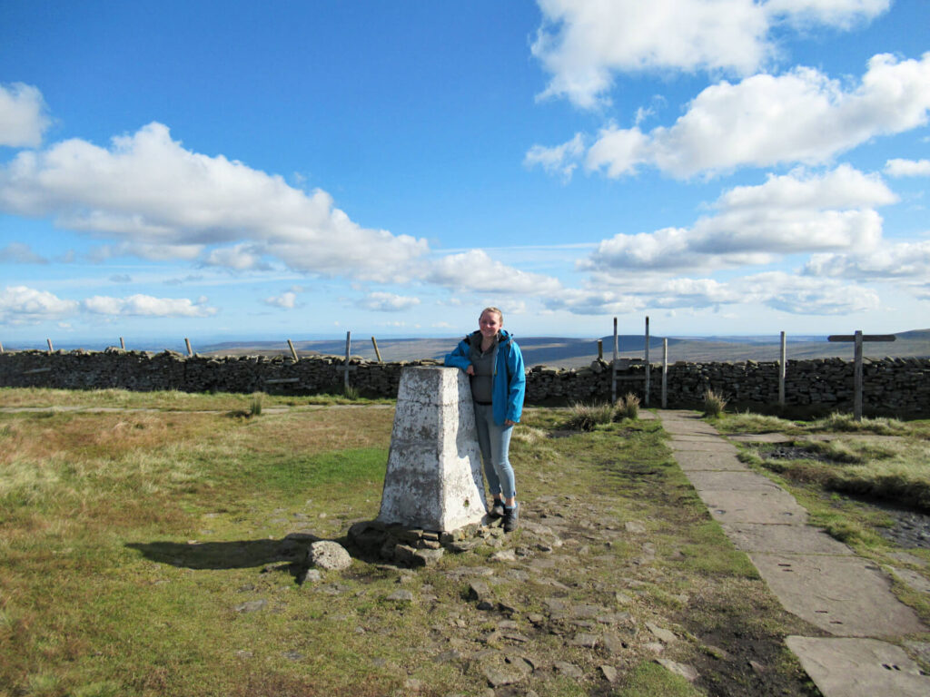 Zoe stood at the summit of Buckden Pike by it's trig point. Beautiful day for a walk!