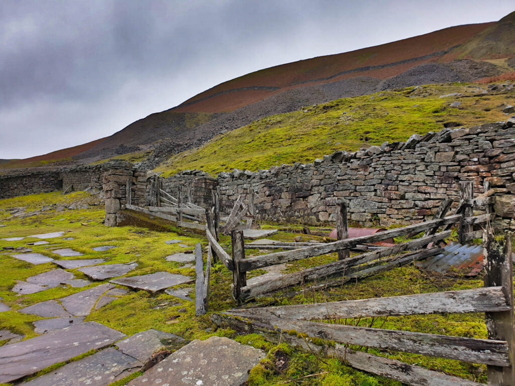 Behind the remains of Crackpot hall are large mounds of slate and rock from its mining days.