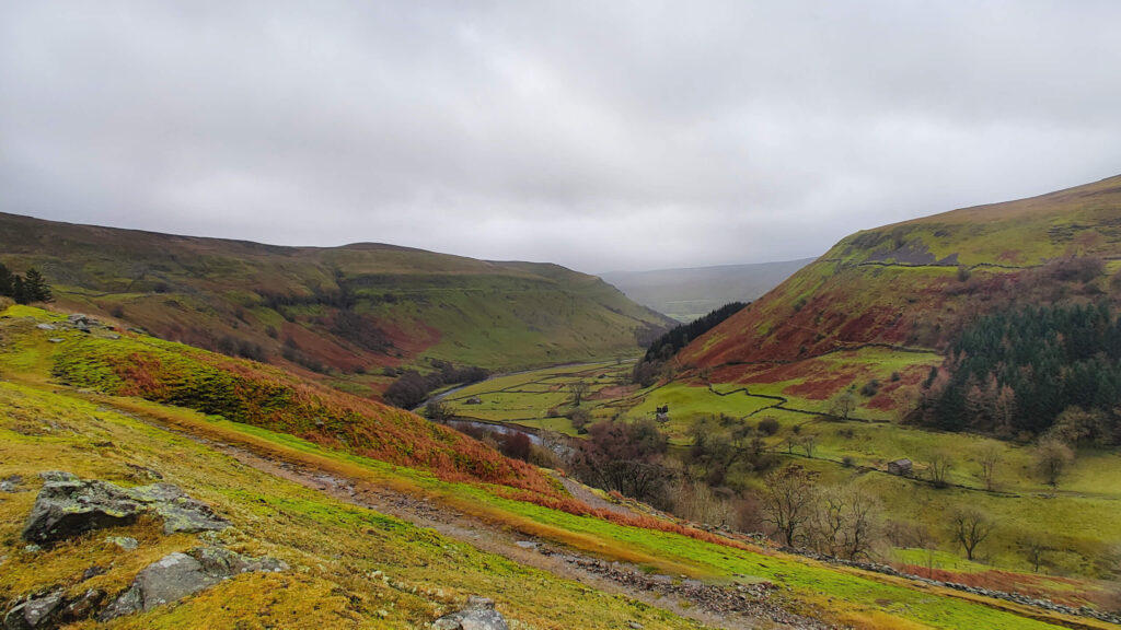 Looking through the valley, The Pennine Trail runs parallel to the river here.