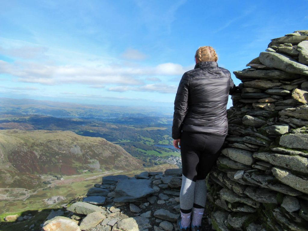 Zoe looking out from the summit of Coniston Old Man