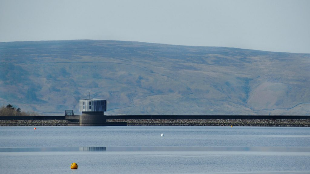 Grimwith Reservoir wall, the walk takes you across this at the end. Rolling Yorkshire Dales hills in the background