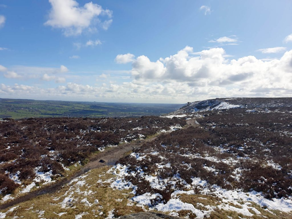 Looking east over Ilkley Moor with the snowy ground clear in the image foreground.