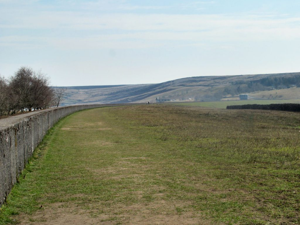 The grassy path along Grimwith Reservoir wall - the home straight of this walk!