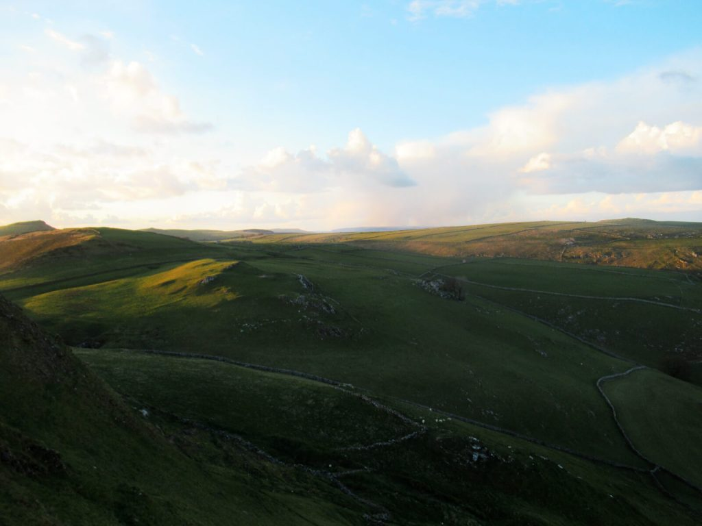 Looking north over the Peak District during this Chrome Hill walk for beautiful rolling hills and blue skies