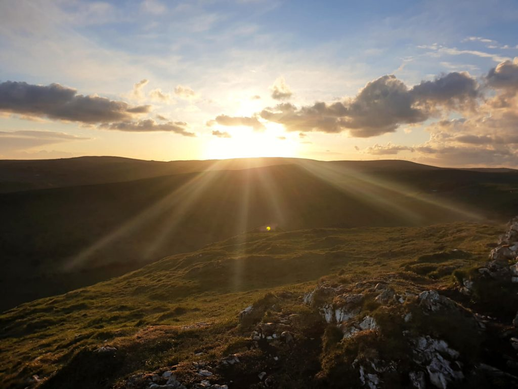The sun sets over the Peak District with a great view from the top of Chrome Hill. The steep walk up Chrome Hill is worth it for this!