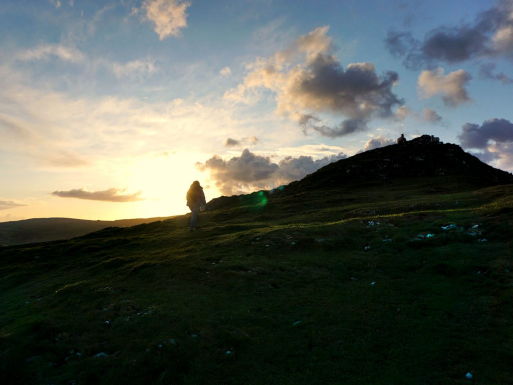 On the final uphill stretch to the peak of Chrome Hill against the glowing sunset in the Peak District