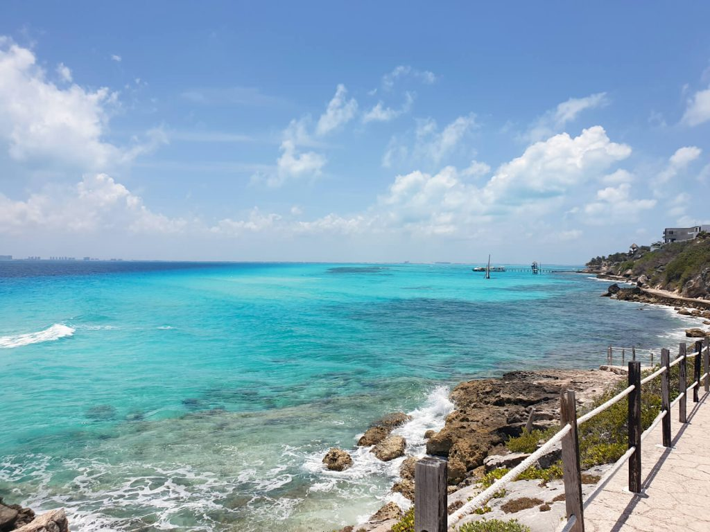 Looking across the water from Punta Sur on Isla Mujeres to Cancun. The water is aqua blue.