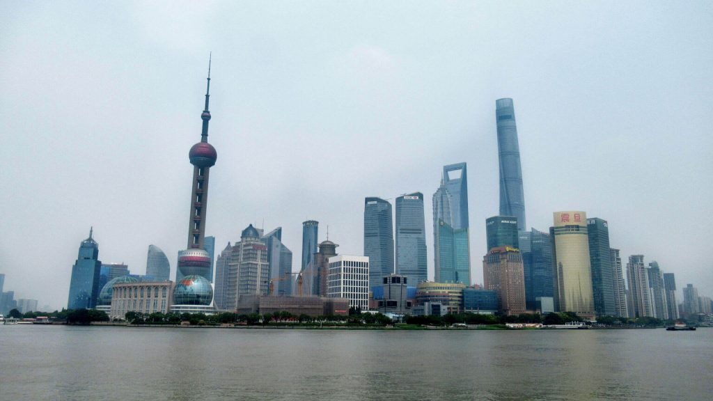 The Shanghai skyline from the Bund on the other side of the river. Noticeable are the Pearl Oriental Tower with it's circular levels and the second tallest building in the world, which looks like a bottle opener. You can see these amazing views during a layover with a China Transit Visa
