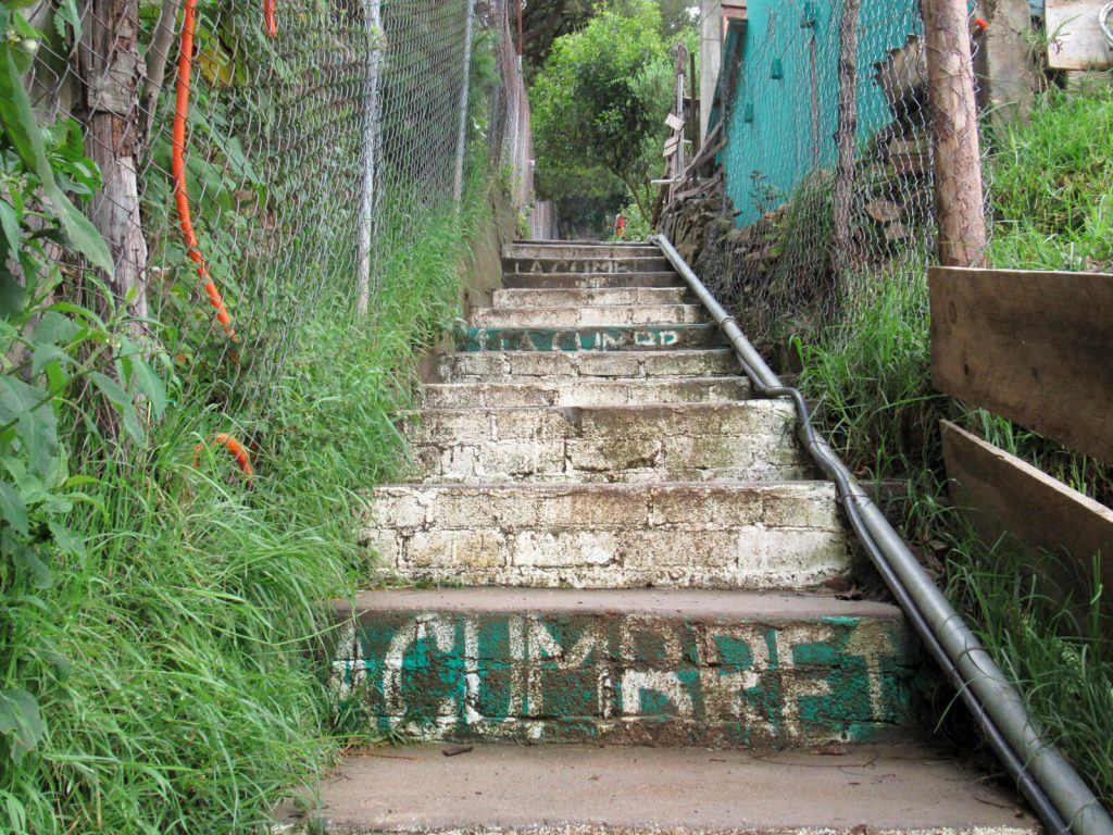 The stairs leading to Cabanas La Cumbre in San Jose del Pacifico. The hostel name is painted on the steps, which lead off from a small road