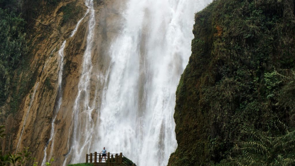 Zoe stood on the viewing platform in front of Cascada Velo de Novia, 1000s of litres of water are crashing down behind her.