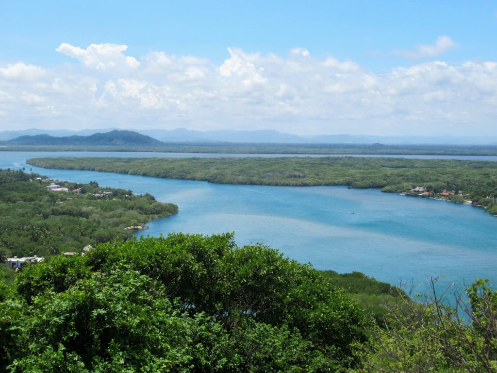 Looking inland over the lagoon estuary and lagoon, with the Oaxaca mountains in the background