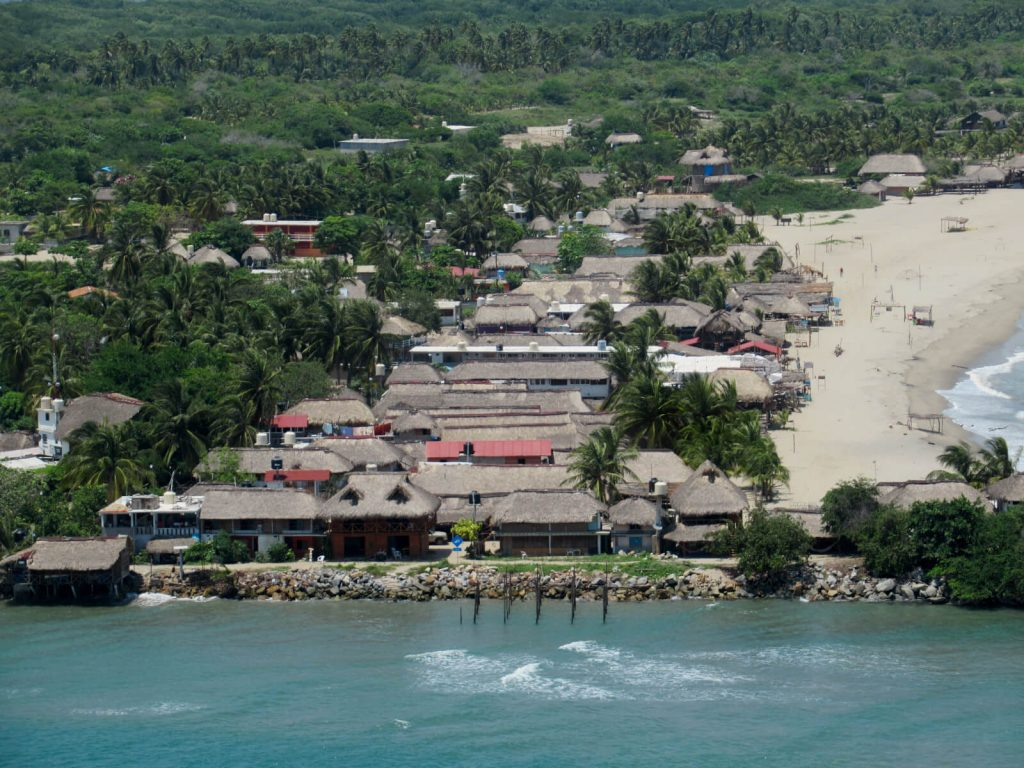 A bird's eye view of the town of Chacahua with it's many cabanas and thatched roofs from the top of the lighthouse