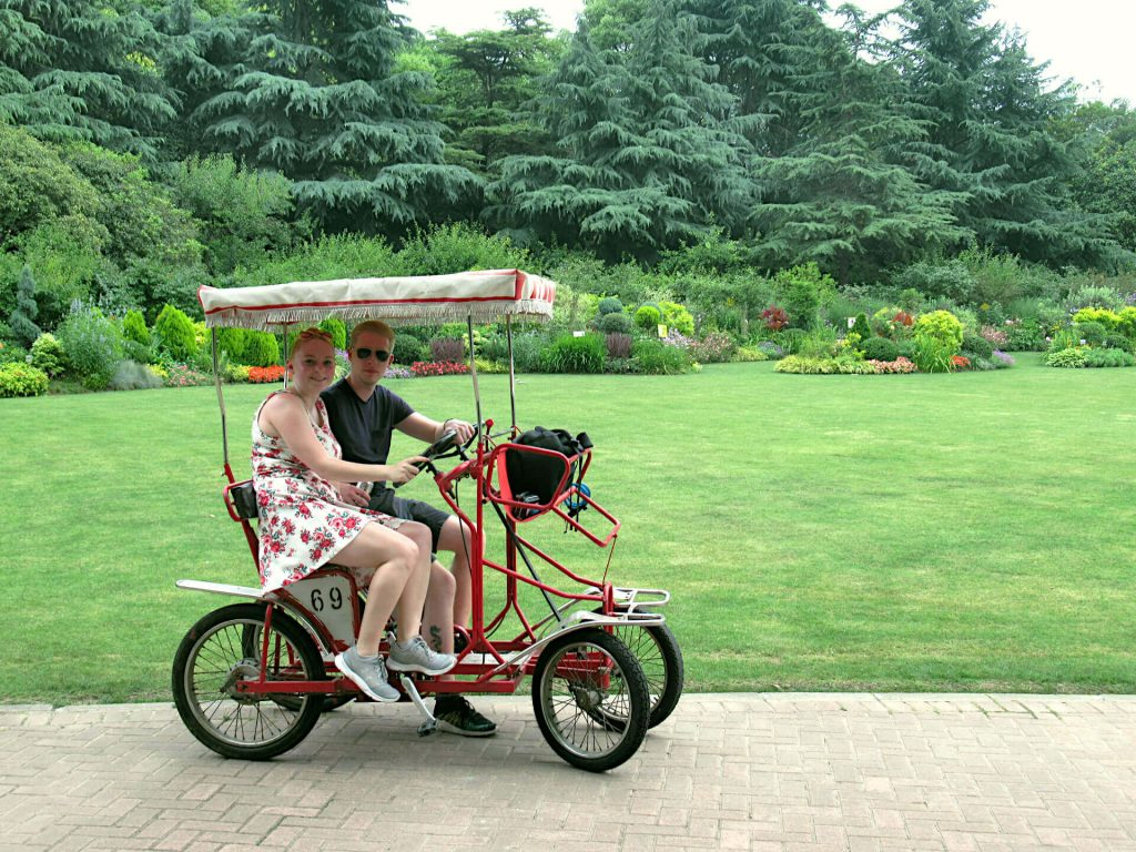 Zoe on a four-wheeled, two-seater bike in Century Park, Shanghai