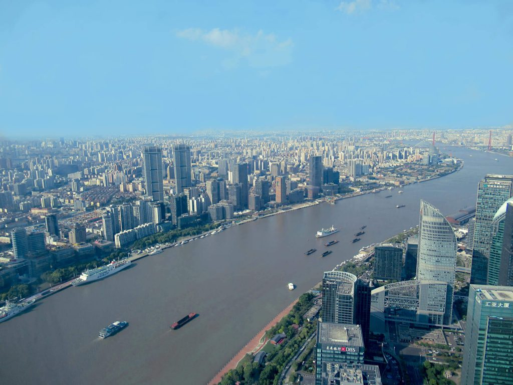 View looking North-West from the top the Pearl Oriental Tower, thousands of high-rise buildings can be seen disappearing into the horizon showing the true scale of the size of Shanghai