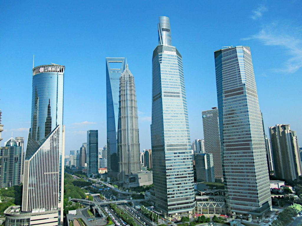 View from the Oriental Pearl Tower in Shanghai of other high-rise buildings including the second tallest building in the world, the sky is perfectly blue with just a few whispers of clouds